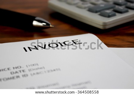 Invoice letter head with pen and calculator / selective focus