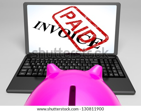 Invoice Paid On Laptop Showing Payment Receipt Or Confirmation - stock photo