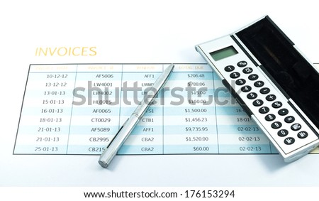 invoice report with calculator and pen for business - stock photo