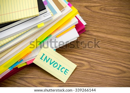 Invoice; The Pile of Business Documents on the Desk - stock photo