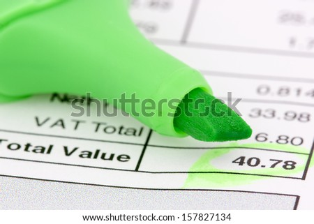 Invoice with balance due, circled in green - stock photo