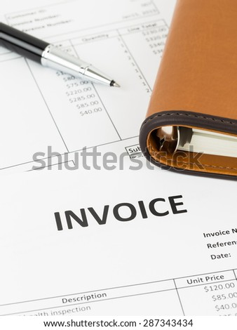 Invoice with pen and organizer; document is mock-up - stock photo