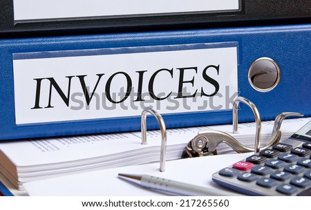 Invoices - blue binder in the office - stock photo