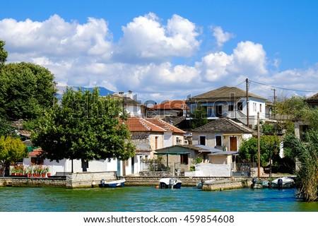 Ioannina island Lake Pamvotida, Epirus region, Greece. Note: focus on houses. - stock photo