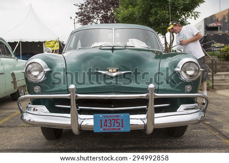 IOLA, WI - JULY 12:  Front view of 1952 Kaiser Virginian Traveler Car at Iola 42nd Annual Car Show July 12, 2014 in Iola, Wisconsin. - stock photo