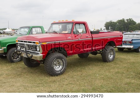 IOLA, WI - JULY 12:  1977 Red Ford F150 Pickup Truck at Iola 42nd Annual Car Show July 12, 2014 in Iola, Wisconsin. - stock photo