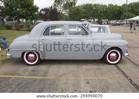 IOLA, WI - JULY 12:  Side of 1950 Plymouth Car at Iola 42nd Annual Car Show July 12, 2014 in Iola, Wisconsin. - stock photo
