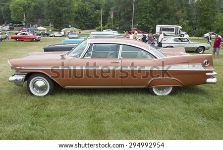 IOLA, WI - JULY 12:  Side of 1959 Plymouth Sport Fury Car at Iola 42nd Annual Car Show July 12, 2014 in Iola, Wisconsin. - stock photo
