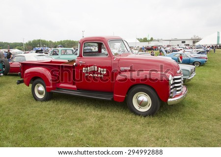 IOLA, WI - JULY 12:  Side view of Vintage Red Chevy 3600 Pickup Truck at Iola 42nd Annual Car Show July 12, 2014 in Iola, Wisconsin. - stock photo