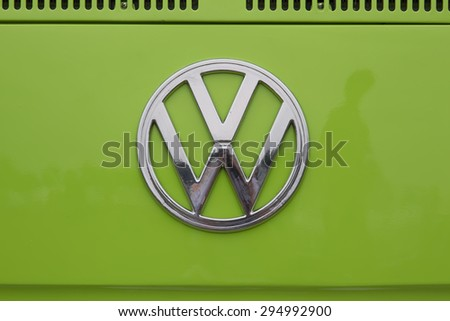IOLA, WI - JULY 12:  Symbol on 1971 Volkswagen VW Van Green Car at Iola 42nd Annual Car Show July 12, 2014 in Iola, Wisconsin. - stock photo