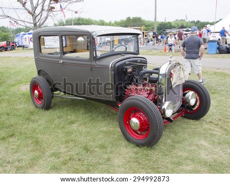 IOLA, WI - JULY 12:  Vintage Gray and Red Ford Hot Rod at Iola 42nd Annual Car Show July 12, 2014 in Iola, Wisconsin.
