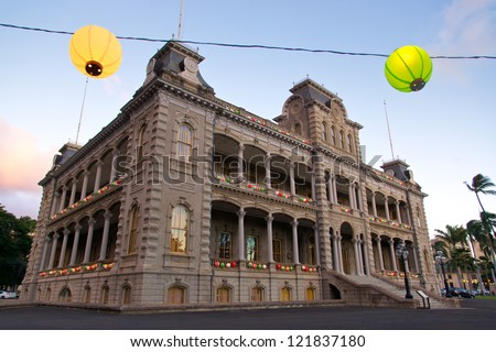 Iolani Palace, the only royal palace in the United States, is decorated with colorful lanterns for the holiday season. - stock photo