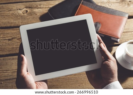 Ipad, business, holding hands. - stock photo