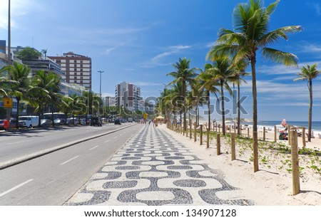 Ipanema beach with mosaic of sidewalk in Rio de Janeiro - stock photo