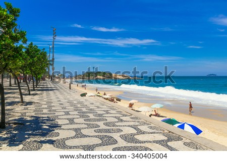 Ipanema beach with mosaic of sidewalk in Rio de Janeiro. Brazil - stock photo