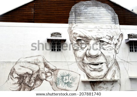 "IPOH, MALAYSIA - circa JULY 2014: ""Old Man Drinking White Coffee"" painted by Ernest Zacharevic in Ipoh."