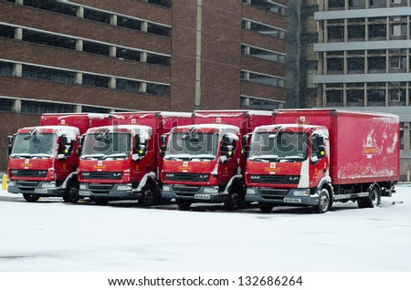IPSWICH, UK - MARCH 24: Royal Mail trucks snowed-in. Severe weather conditions are causing disruptions to services in many parts of Northern England on 23-24 March 2013. - stock photo