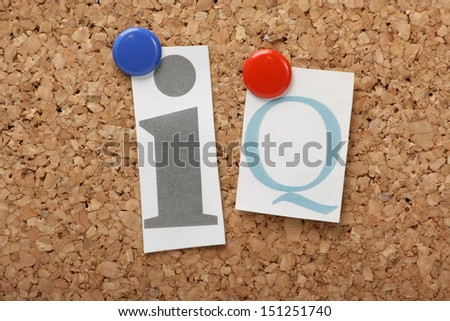 IQ or Intelligence Quotient in cut out magazine letters pinned to a cork notice board.  - stock photo