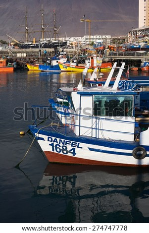 IQUIQUE, CHILE - JANUARY 22, 2015: Fishing boats anchoring in the harbor on January 22, 2015 in Iquique, Chile. Iquique is a free port city in Northern Chile.  - stock photo