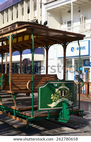IQUIQUE, CHILE - JANUARY 22, 2015: Old open tram waggon with wooden seats on Plaza Prat main square along Baquedano avenue on January 22, 2015 in Iquique, Chile