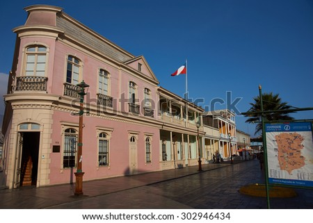 IQUIQUE, CHILE - JULY 7, 2015: Historic buildings lining Baquedano Street in the coastal city of Iquique in northern Chile, Most buildings date back to when the city grew rich from nitrate mining.  - stock photo