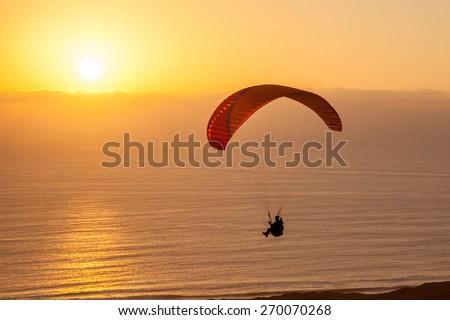iquique paraglider / atacama paraglider/ iquique paraglider - stock photo