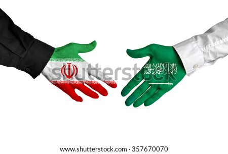 Iran and Saudi Arabia leaders shaking hands on a deal agreement - stock photo