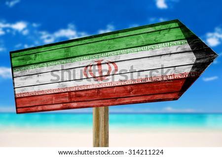 Iran Flag wooden sign on beach background