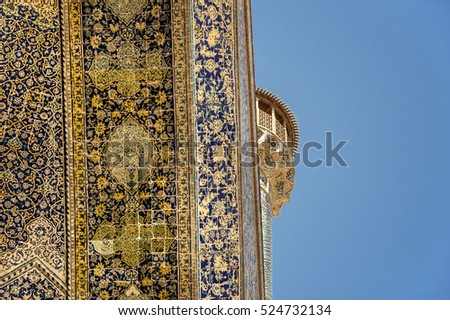 Iran, Isfahan, Naqsh-e Jahan Square (Meidan-e Naghsch-e Dschahan) - October 08, 2016: Entrance iwan of the Shah Mosque (Imam Mosque) with its towering facade, oriental ornaments and minaret.
