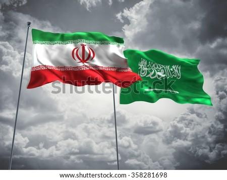 Iran & Saudi Arabia Flags are waving in the sky with dark clouds. - stock photo