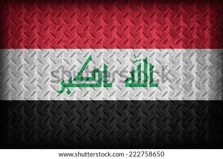 Iraq flag pattern on the diamond metal plate texture ,vintage style - stock photo