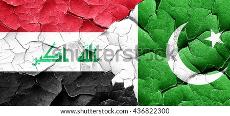 Iraq flag with Pakistan flag on a grunge cracked wall