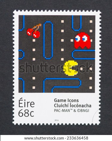 IRELAND - CIRCA 2014: a postage stamp printed in Ireland showing an image of Pac-Man a video game character, circa 2014.  - stock photo