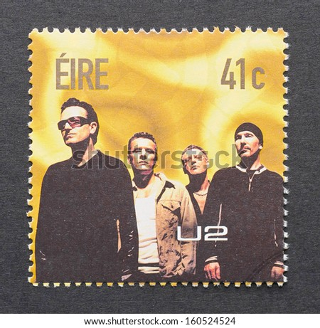 IRELAND - CIRCA 2002: a postage stamp printed in Ireland showing an image of U2 band, circa 2002.  - stock photo