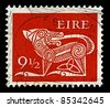 """IRELAND-CIRCA 1979:A stamp printed in IRELAND shows image of """"Dog"""" part of an old Irish decorative brooch, circa 1979. - stock photo"""