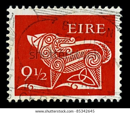"IRELAND-CIRCA 1979:A stamp printed in IRELAND shows image of ""Dog"" part of an old Irish decorative brooch, circa 1979."