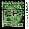 "IRELAND-CIRCA 1922: A stamp printed in IRELAND shows image of National symbols Ireland ""Sword of light"", circa 1922. - stock photo"