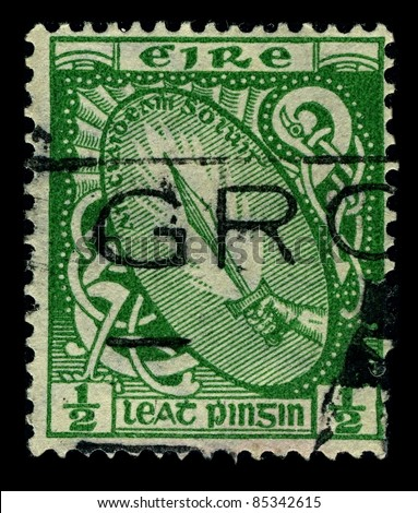 "IRELAND-CIRCA 1922: A stamp printed in IRELAND shows image of National symbols Ireland ""Sword of light"", circa 1922."
