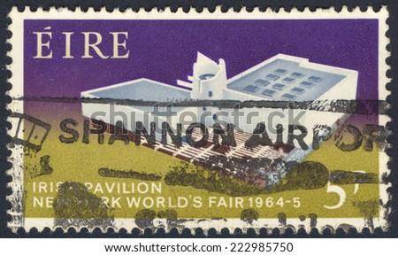 IRELAND - CIRCA 1964: A stamp printed in Ireland shows Irish Pavilion, New York World's Fair, 1964, circa 1964 - stock photo