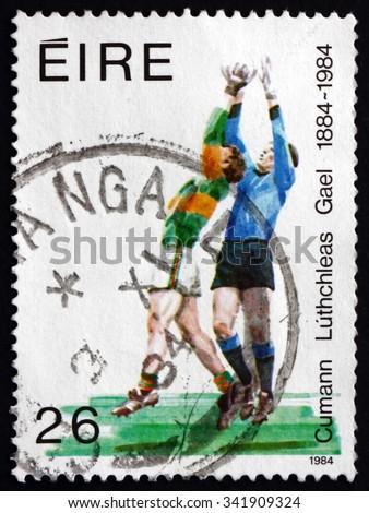 IRELAND - CIRCA 1984: A stamp printed in Ireland shows Soccer, Centenary of the Gaelic Athletic Association, circa 1984 - stock photo