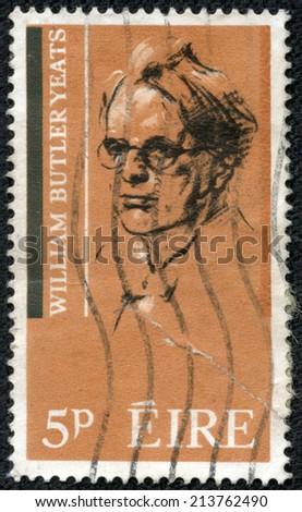 IRELAND - CIRCA 1965 : A stamp printed in Ireland shows William Butler Yeats - Irish poet and playwright, 1865-1939, circa 1965 - stock photo