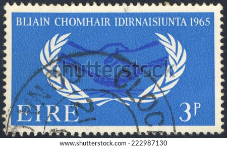 IRELAND - CIRCA 1965: A stamp printed in Ireland shows 1965 Year of International Co-operation, circa 1965 - stock photo