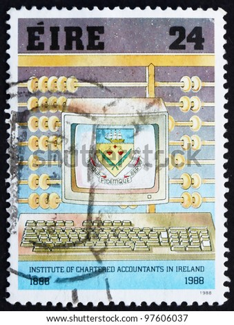 IRELAND - CIRCA 1988: A stamp printed in the Ireland shows Abacus and Personal Computer, Centenary of Institute of Chartered Accountants, circa 1988 - stock photo