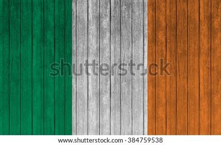 Ireland Flag on old wood texture background - stock photo