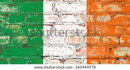 Ireland flag painted on old brick wall texture background - stock photo