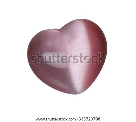Iridescent pink heart stone that shimmers in the light - path included - stock photo