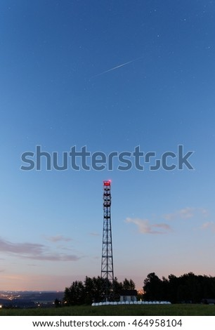 Iridium satellite flare above a mobile phone pylon.