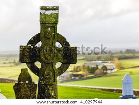 Irish celtic cross in Rock of cashel cemetery - stock photo