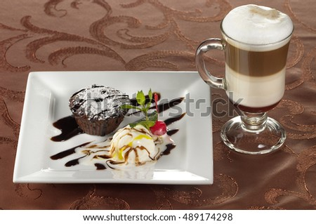Irish coffee and dessert in special glass over fabric