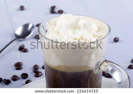 irish coffee in a glass mug with spoon and coffee bean - stock photo